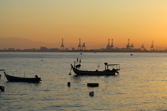 Fishing boats and the port cranes in the background