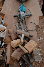 All tools for the build are laid on the keel timber for the blessing ritual.